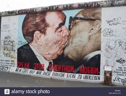 dmitry-vrubels-mural-of-communist-leaders-honecker-and-brezhnev-kissing-d9466x