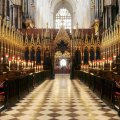Westminster Abbey interior Choir stalls candle light gothic architecture London England UK nave Medieval architectureEnglish