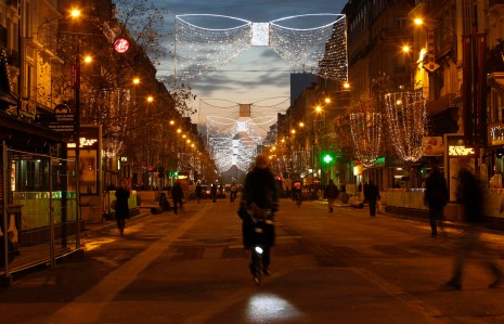 A cyclist makes her way along a pedestrian street lit with Christmas decorations in central Brussels at dusk on Monday, Nov. 23, 2015. Three days of the highest terror alert and unprecedented measures that have closed down the city's subways, schools and main stores, has created a very different atmosphere as the Belgian capital tries to avoid attacks similar to the ones that caused devastating carnage in Paris. (AP Photo/Alastair Grant) ORG XMIT: XAG111